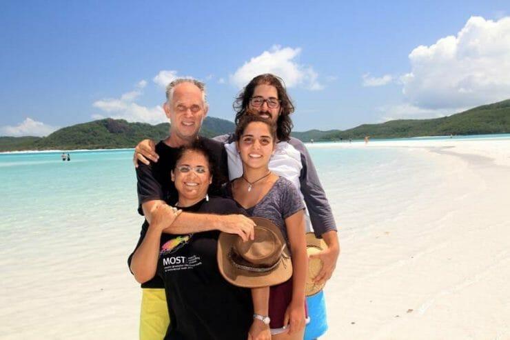 Happy family on Whitehaven beach