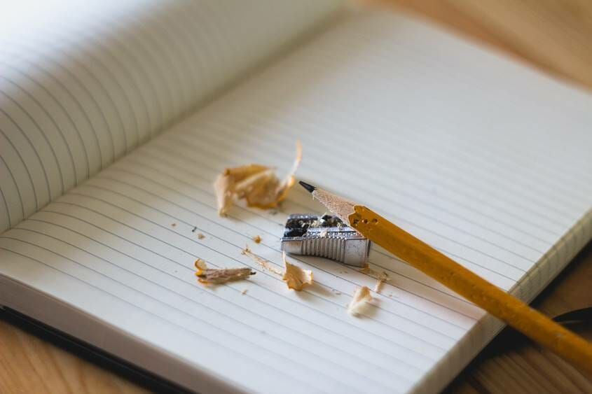 Pencil and sharpener on a notebook - sharpen your pencil and write a journal