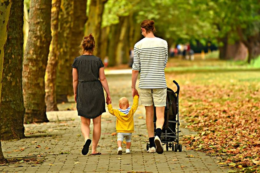 Young parents with a small child in a park