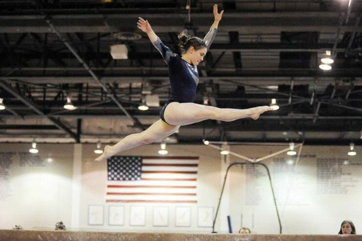 Gymnast jumping high in the air