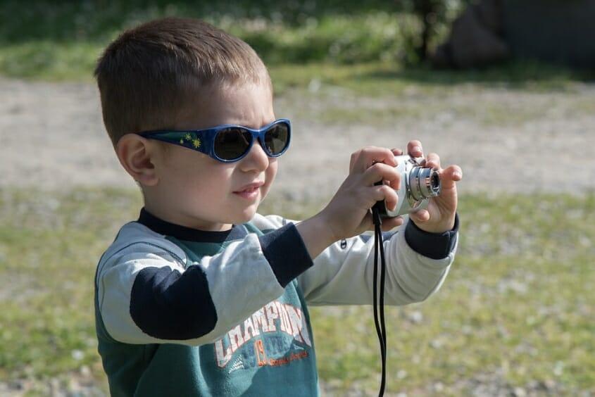 Boy wearing tinted glasses