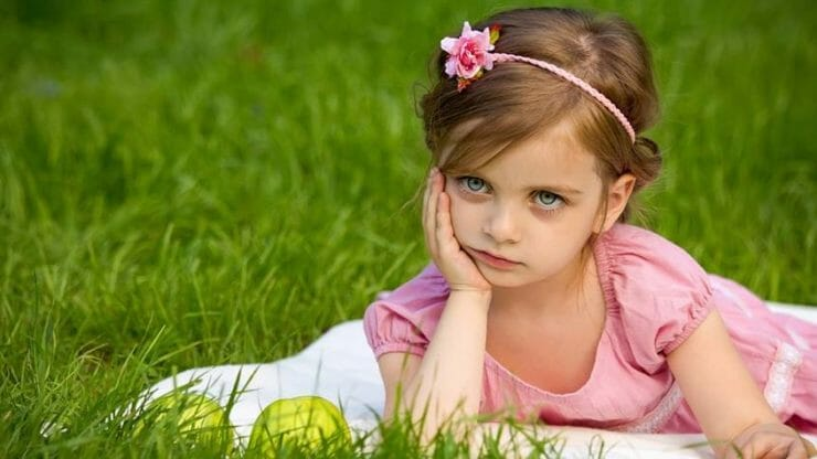 Little girl looking bored