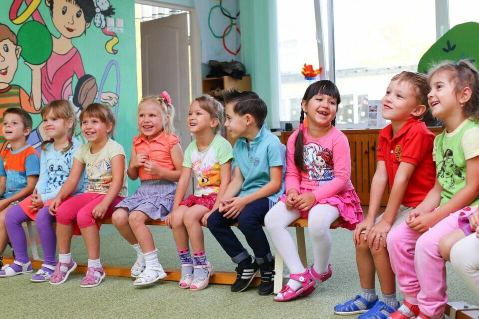 Happy kids in Kindergarten class