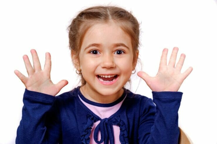 Girl showing her hands with excitement