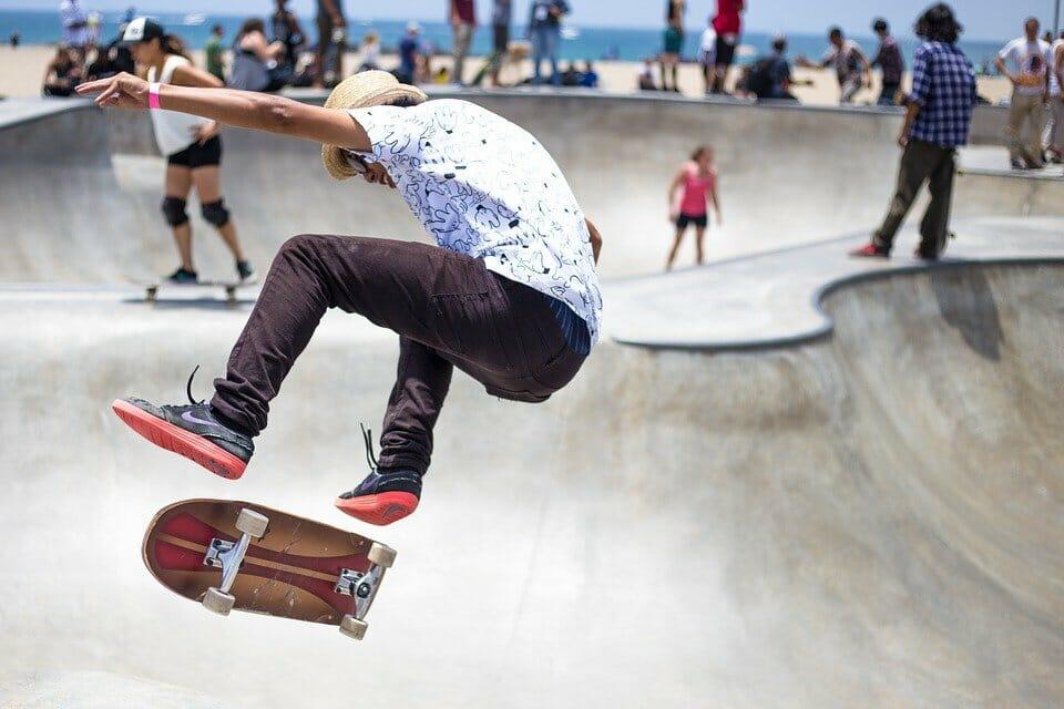 Boy doing skateboard tricks at a skate park