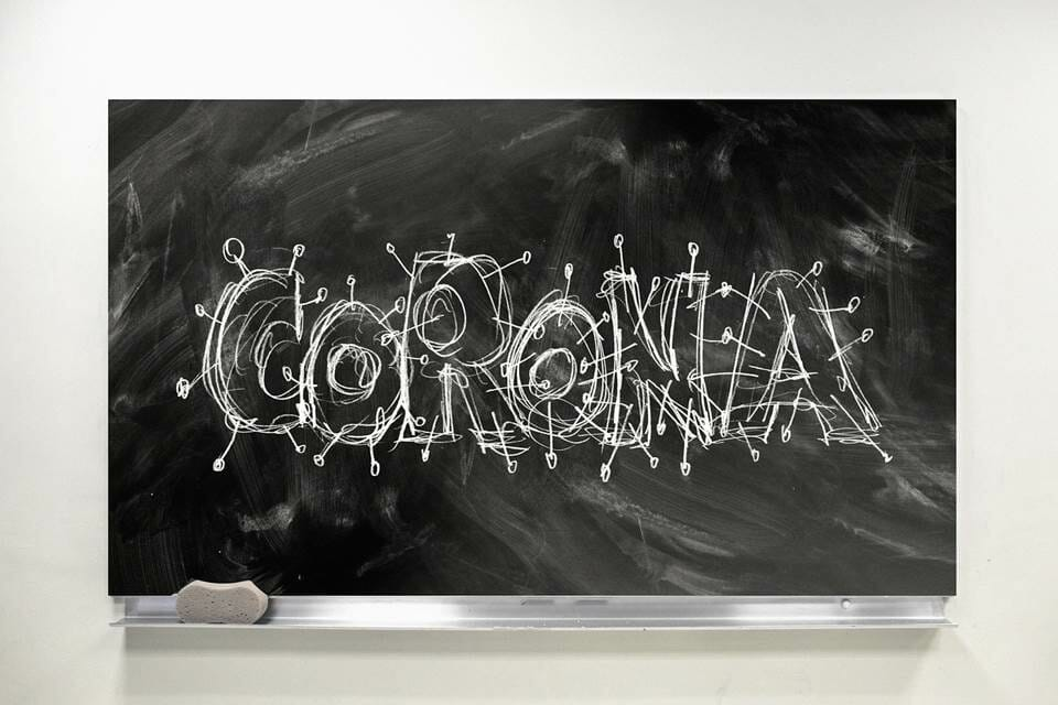 The word'Corona' written on a classroom blackboard