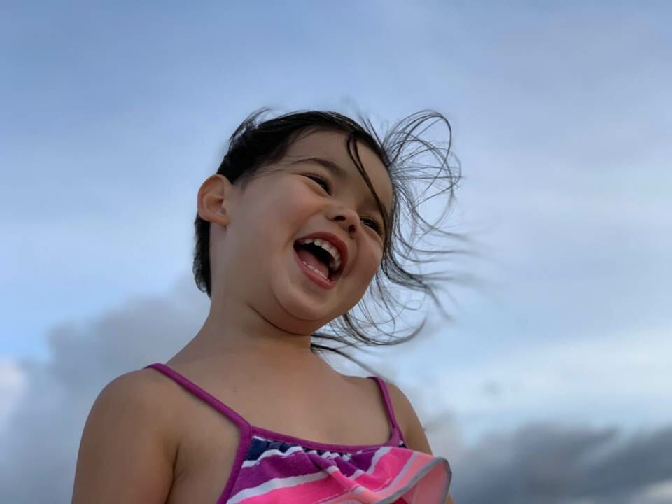 Little girl looking happy and excited