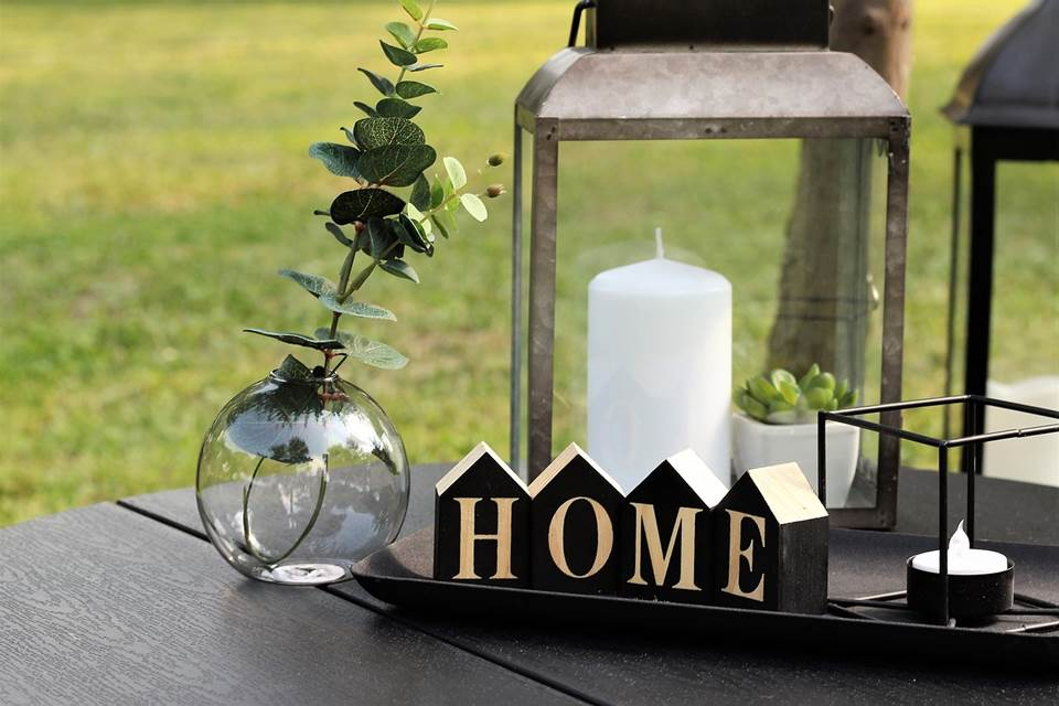 Stylish dining table setup with a HOME sign