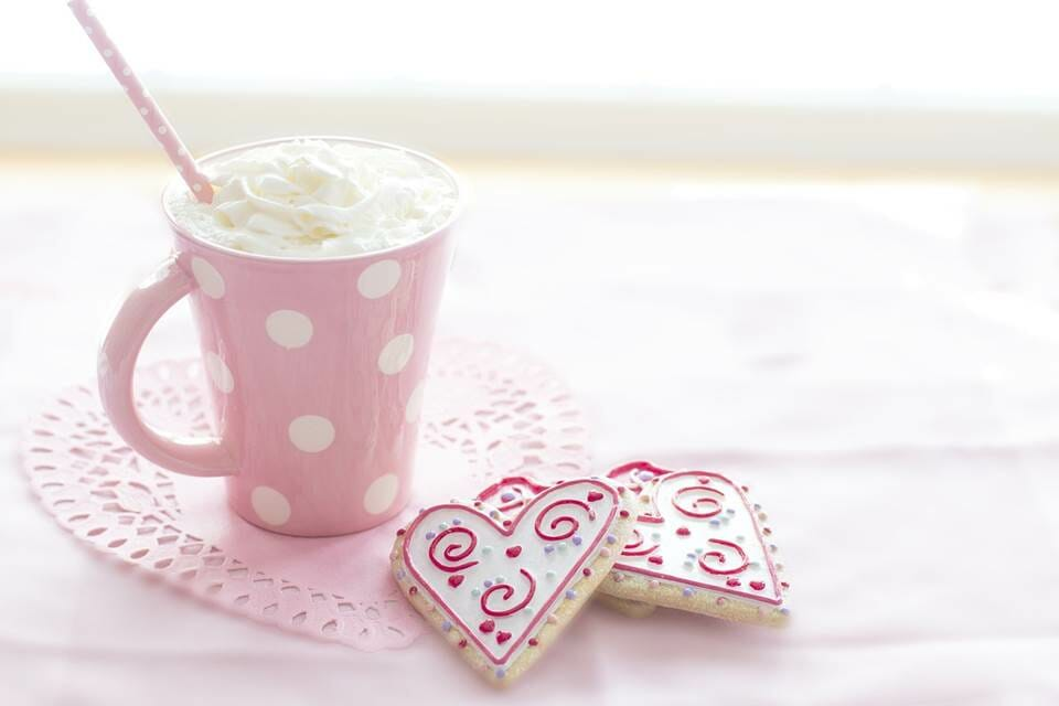 Whipped cream beverage and heart shaped cookies