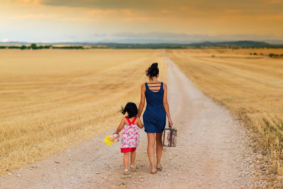 Mother and daughter on a country dirt road
