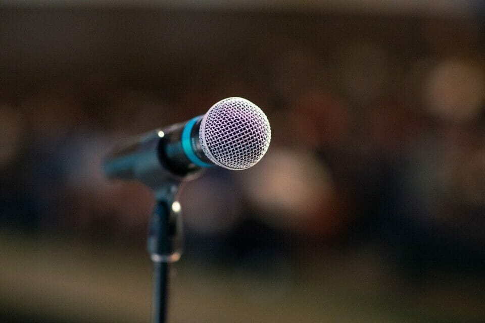 Microphone and blurred audience - the fear of public speaking