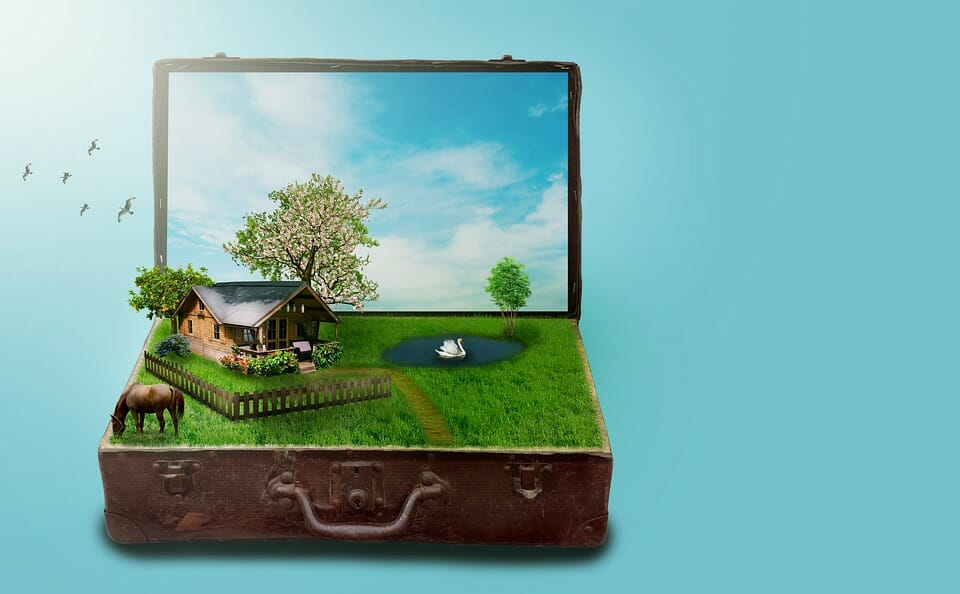 Staycation: suitcase with a laptop screen containing a home and a yard