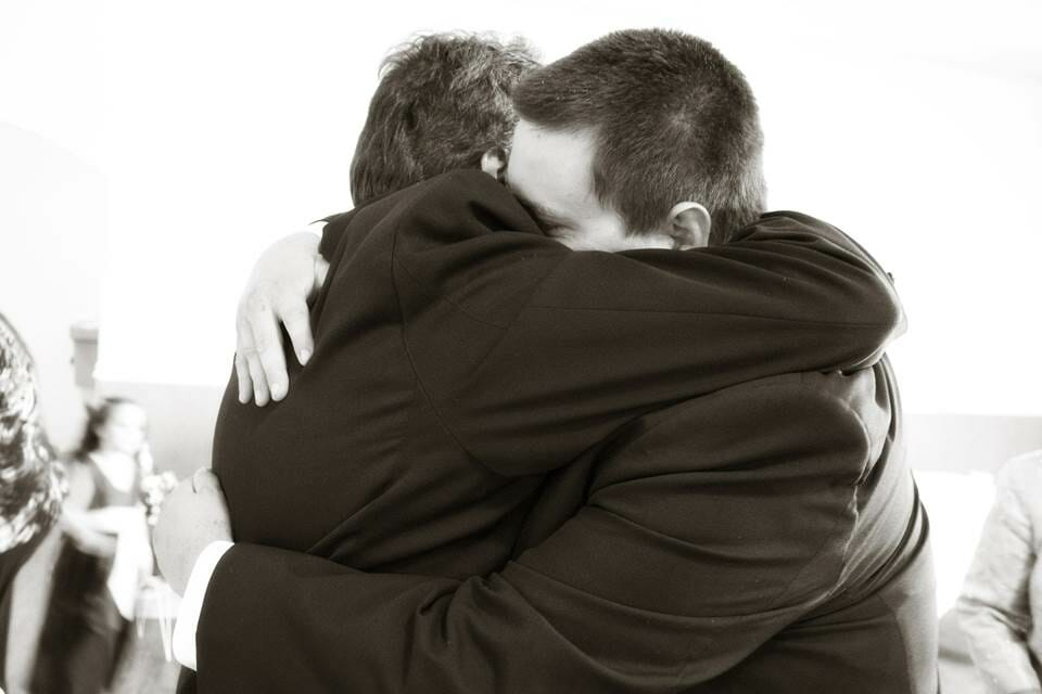 Two people hugging deeply