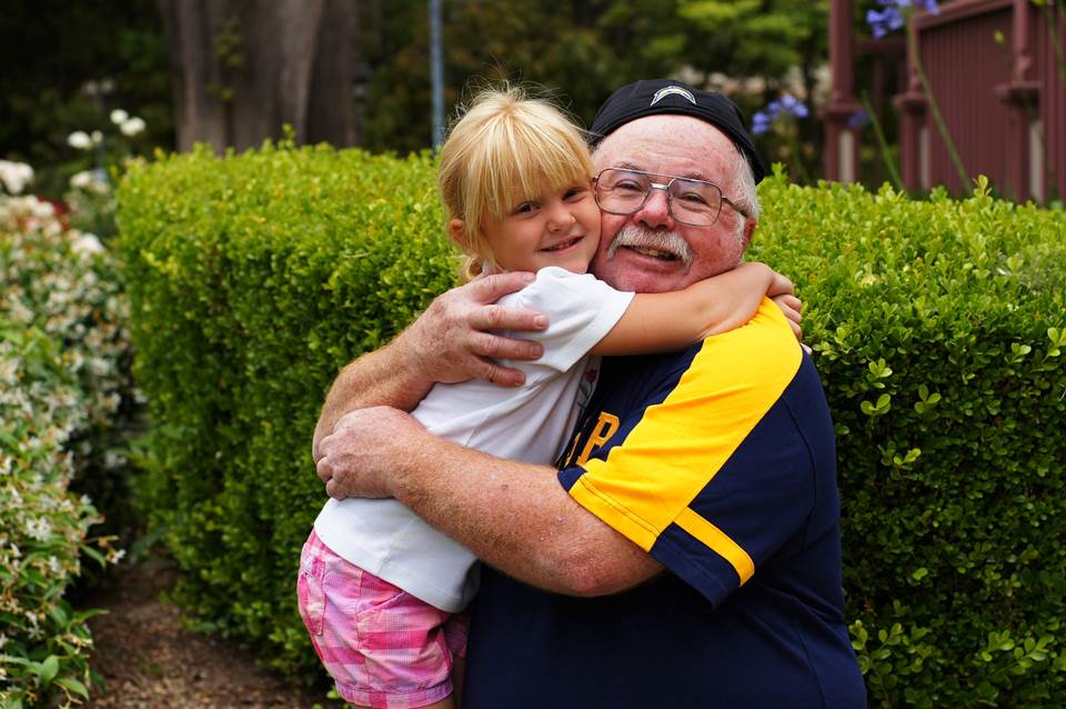 Granddaughter and grandfather hugging