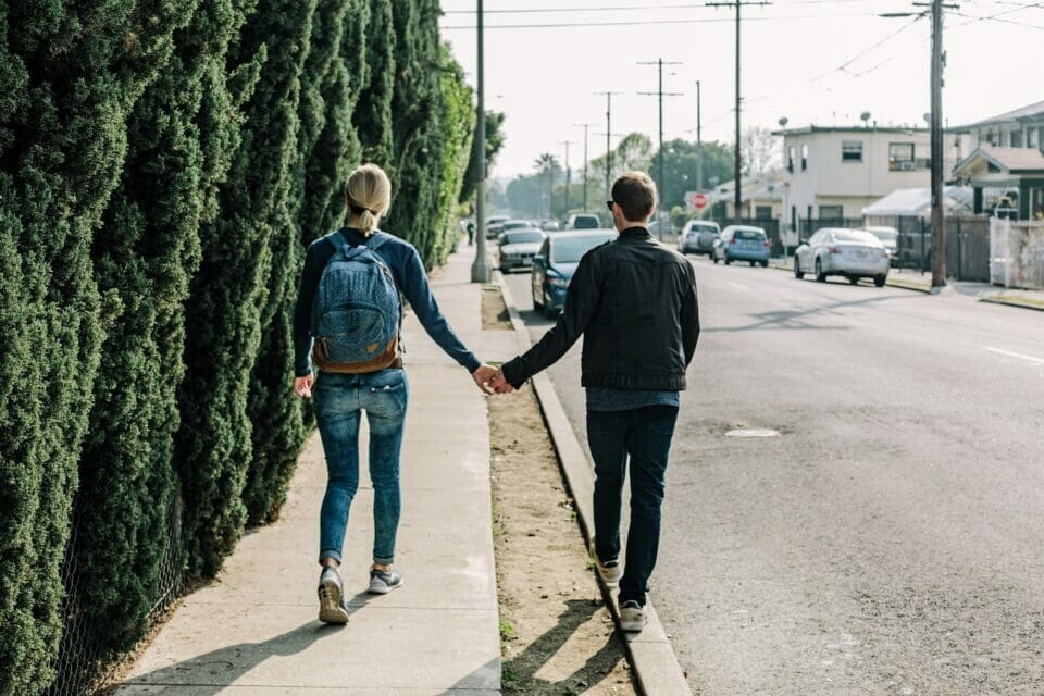 Couple walking hand-in-hand on a street