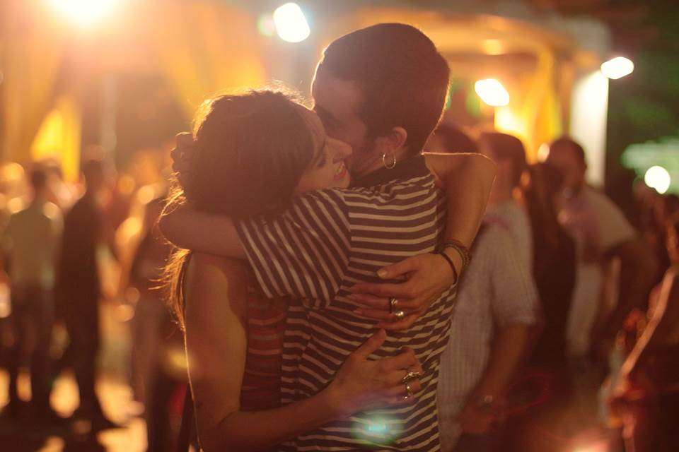 Young man and woman hugging at a party
