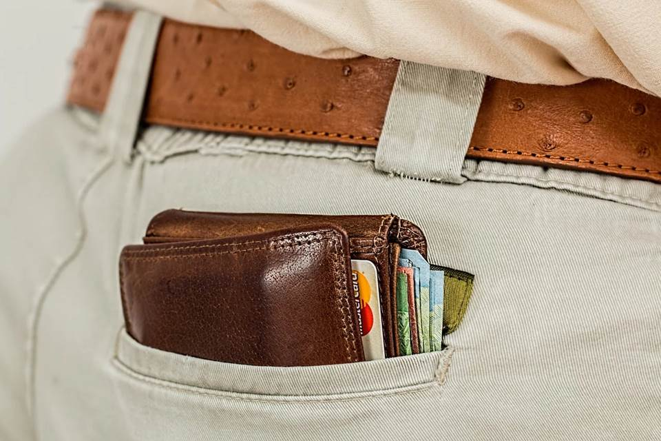 Man's wallet sticking out of his pants