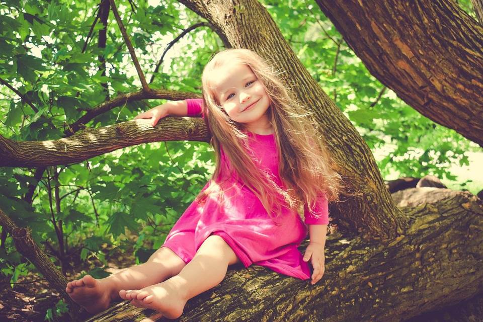Girl smiling in a tree